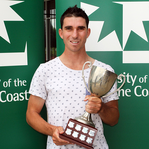 Para-cyclist Kyle Bridgwood holding the 2015 Sportsperson of the Year trophy.