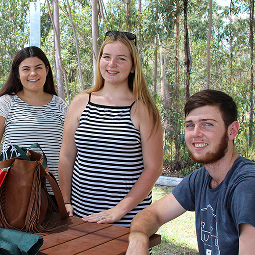 Chloe Johnston and Emily Allward and Nicolas Gerrard relaxing over lunch at USC Gympie's Orientation Day.