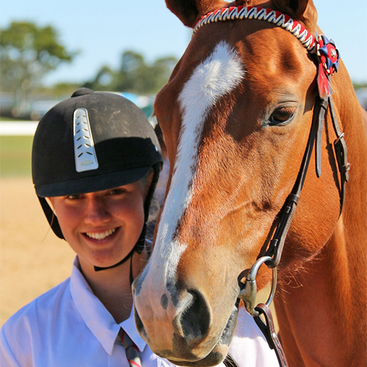 USC Animal Ecology student Grace Prince with her favourite horse Pip