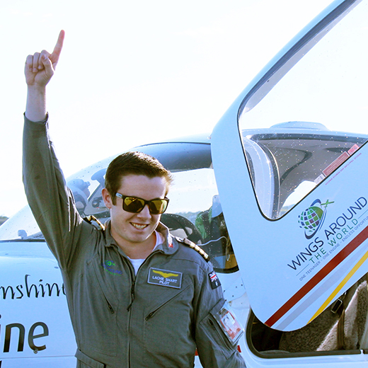 Lachlan Smart celebrates the completion of his solo flight around the world
