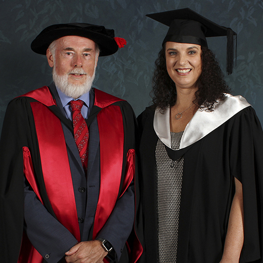 USC's Professor John Bartlett congratulating Emma Stevens at her graduation ceremony.
