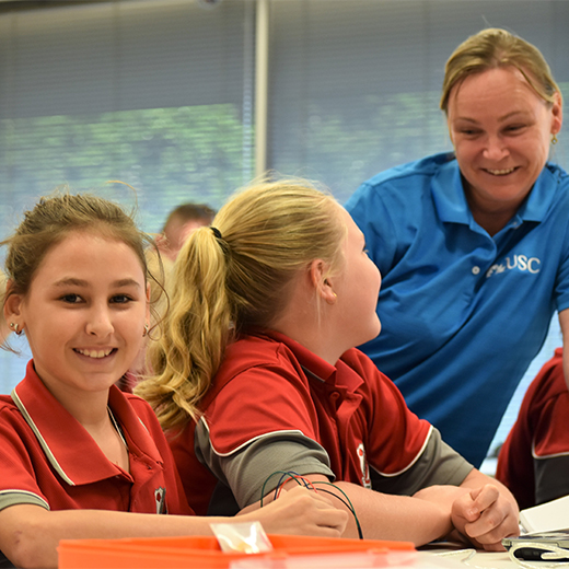 Urangan State High School Year 7's Jorja Appo-Steven and Chelsea Farrow with USC Primary Education student Julie Curtis.