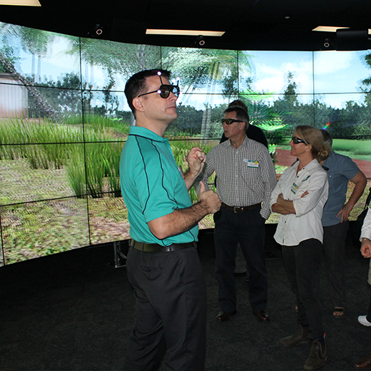 Participants check out USC's visualisation facilities.