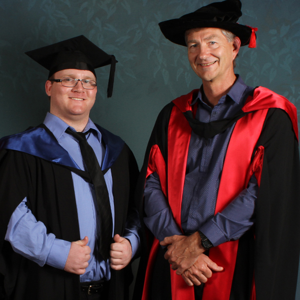 Criminology graduate Cody Smith and Professor Tim Prenzler. Photo: Reed Graduation Services
