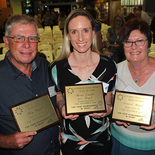 Ray and Denise Boyd with their daughter, Alana Quade, celebrate becoming inductees of the Sunshine Coast Sports Hall of Fame at USC