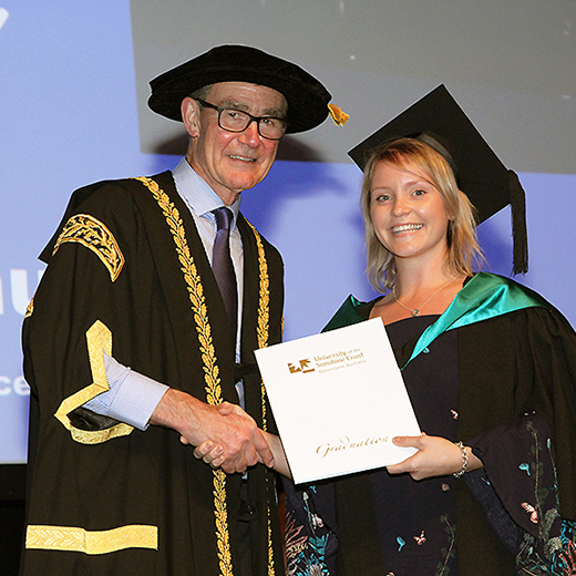USC graduate Elle Wildermuth of Redcliffe receiving her Business degree from USC Chancellor Sir Angus Houston AK, AFC.