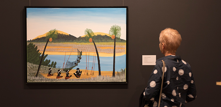 A visitor enjoying Future Tense: Two Decades of Gifts from the Collection. Photo: Barry Alsop.