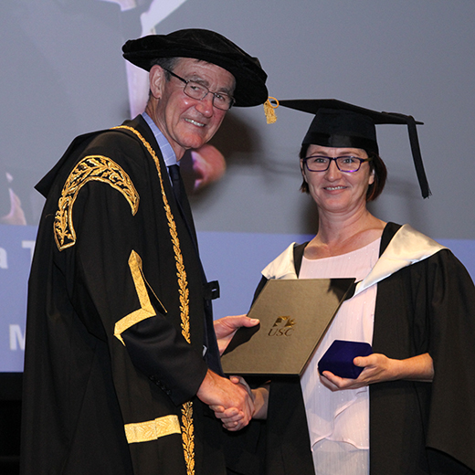 Gympie's Vanessa Tyson from Gympie is presented with a University Medal from Chancellor Sir Angus Houston at her USC graduation
