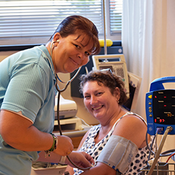 USC Nursing Science student Kelly Scott conducts health checks on Crystel Schuchmann in the USC Fraser Coast nursing labs.