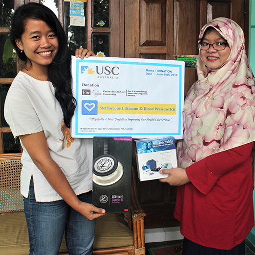 Wida Kristiawati and Laila Rizqi Karima with medical equipment donated by USC students and the Gympie community.