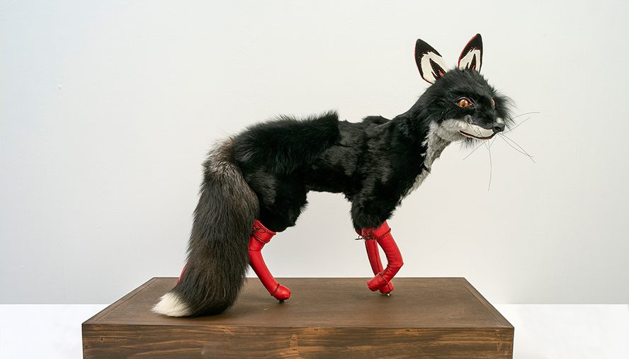 Beata BATOROWICZ; The Black Fox in Red Leather Boots; 2018; leather, fox tail, fur, suede, leather and wood; Courtesy of the artist