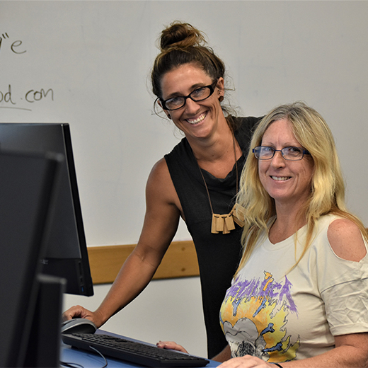 Diploma student Carolyn O'Donnell with USC adviser Liz Davison at a recent University Skills for Community course at USC's Fraser Coast campus
