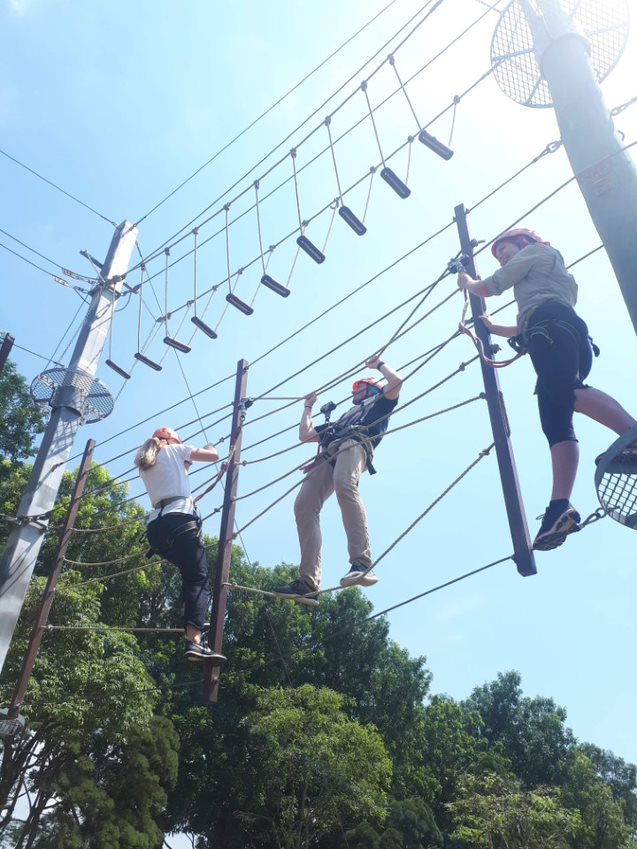 Rachel Gibson, Cory Marschall and Billie Tonks have a go on the high ropes course at a Ministry of Education Outdoor Adventure Learning Centre