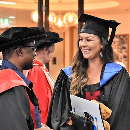 USC Lecturer in Social Work Dr Kate Jonathan congratulates new Human Services graduate Christielle Van Baars at USC's first Fraser Coast graduation ceremony in April last year.