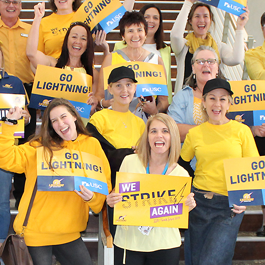 USC staff wear yellow to work in support of Sunshine Coast Lightning in the grand final