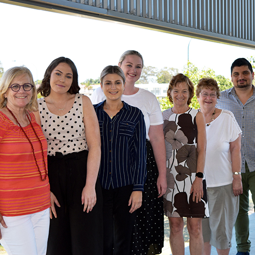 USC Fraser Coast students, Dr Shahab Pourfakhimi and members of the Maryborough Mural Project committee.