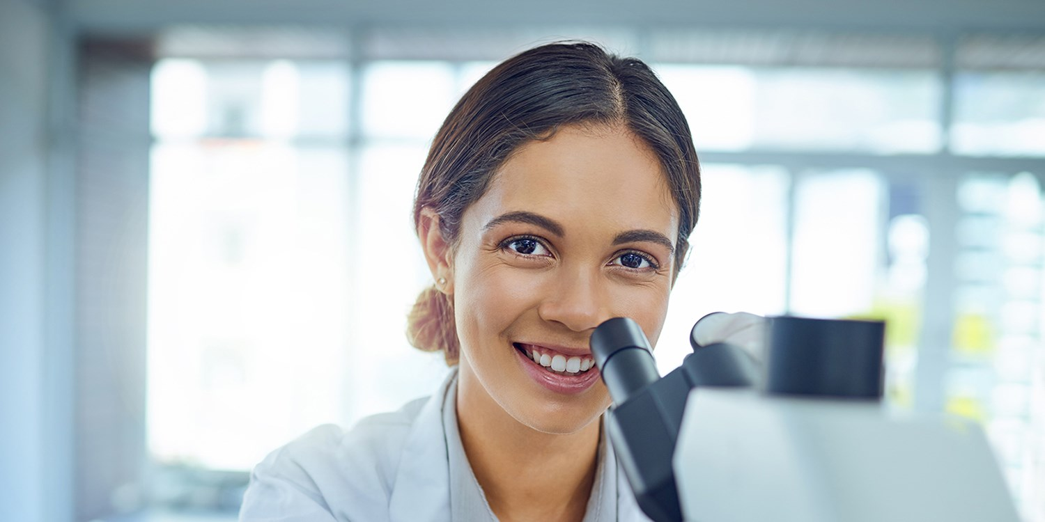 Lady looking into microscope