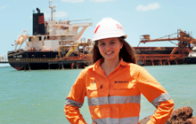 USC Public Relations graduate Lucy Warren in front of Rio Tinto Alcan Weipa's shiploading wharf