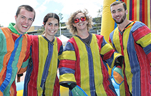 Hamish McHugh, Larissah Clark, Brayden Robinson and Dylan Brooks dress up in Velcro suits for their go on the Sticky Wall at USC's New Semester Fiesta