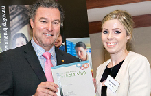 Environmental Science student Brittany Elliot receives her scholarship from Minister John-Paul Langbroek