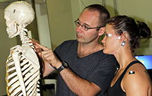 PhD student Lee Daffin explains his spinal posture testing to Science Honours student Cecilia Severin