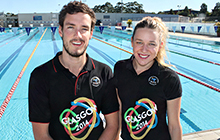 USC students Blake Cochrane and Tessa Wallace near the USC pool