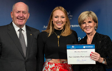 Governor-General Sir Peter Cosgrove and Foreign Affairs Minister Julie Bishop congratulate USC student Tess Harwood on her achievement