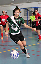 Futsal player Bianca Connell receives a pass in USC's grand final match against Griffith University.
