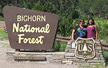 USC student Jennie Briese and Nicole Copley at the entrance to Bighorn National Park in Wyoming