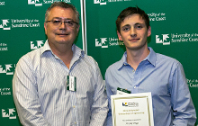 Unity Water CEO George Theo and Jake Briggs holding scholarship certificate