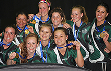 USC women's futsal team members display their gold medals at the Australian University Games