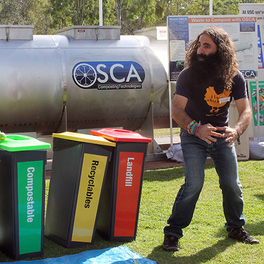 Costa Georgiadis with recycling bins and composting machine