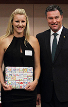 Ashleigh Kahler receives her award from Minister for Education, Training and Employment John-Paul Langbroek.