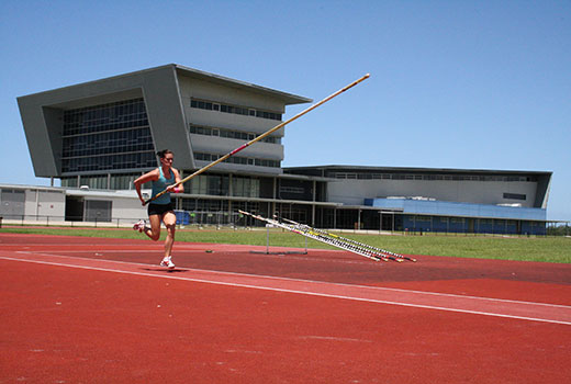 Pole vault on the athletics track at USC's Sport Stadium