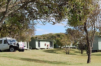 The Fraser Island Research and Learning Centre at Dilli Village has comfortable bunkhouses, self-contained cabins and an open grassed area for camping.