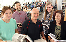 Anja Jennings with, from left, her brother-in-law Jamie Unsworth, brother Murdoch Jennings, father Tony Jennings and her partner Caine Lanigan in the USC Library